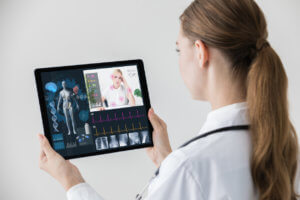 How Much Speed Do you Need: A doctor check looks at a tablet that has her patients vitals and a video chat