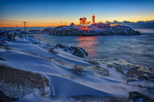 Cape Neddick lighthouse, the Nubble light, stands watch over a wintry landscape on a January morning.