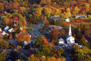 "The fall foliage surrounds a quaint New England village in an aerial <g class=""gr_ gr_157 gr-alert gr_spell gr_inline_cards gr_run_anim ContextualSpelling ins-del multiReplace"" id=""157"" data-gr-id=""157"">photogrph</g>"