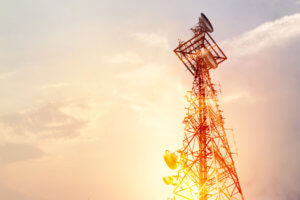 A wireless tower in a sunset.