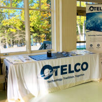 OTELCO's sponsor table was covered in information about municipal broadband.
