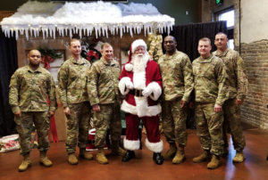 A picture of Santa and a group of military men at Swamp Tails, at Oneonta AL