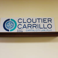 The sign for Capital City law, a proud partner of OTELCO Cloud and Managed Services