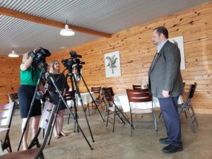 OTELCO's Trevor Jones speaking with reporters at Tuesday's press conference. A picture from one of the top OTELCO Blog posts of 2019.