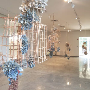 Rebecca Hutchinson's armature woven of natural materials suspends from a cealing