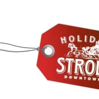 "The Holiday Stroll graphic, a red tag that say ""Holiday Stroll Downtown"" with a white outline Sonta, on a horse drawn sleigh."