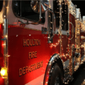 A Houlton Fire Department truck with Christmas Lights on it