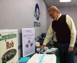 Rob Souza cutting his retirement cake.