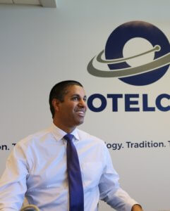 A picture of FCC chairman Ajit Pai with the OTELCO banner behind him in one of OTELCO's conference rooms. Pai has been a proponent of broadband legislation and expansion.