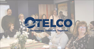 OTELCO employees laugh together in the boardroom. Review our career opportunities to learn how you can join them!