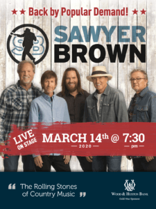 """The Sawyer Brown Band poster, with a picture of the band, their logo, and a red banner that reads  """"Live On Stage March 14th, 2020, @ 7:30 pm"""" and below that a blue footer that says """"the Rolling Stones of Country Music"""" and Wood & Huston Bank, Gold Star Sponsor."""""""